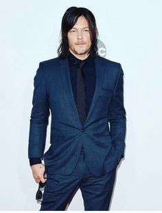 Norman Reedus at the AMA awards on 11/22/2015. I have no idea what filter was used to completely change the color of his suit.