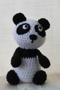 Penny the panda. Amigurumi plush animal. The animal is approximately 20 cm tall.