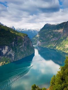 A Fjord in Norway - a narrow sea inlet with cliffs or steep slopes on the sides      from School Educational Trips