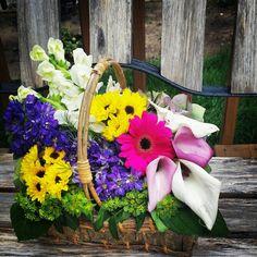 Summer floral arrangement basket