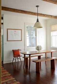 The couple's friend Jason Pickens, a Brooklyn furniture designer, gave them the walnut benches as a going-away present when they moved to Charleston. The 18-inch Vintage French Farmhouse Pendant light ($389) is from Restoration Hardware.