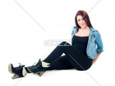 sultry young female - Shot of a young woman sitting with legs out. Model: Sierra Walsh
