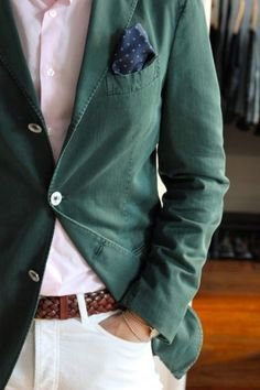 """Summer blazers don't always have to be blue...the very casual nature of summer dressing gives lots of latitude in dressing options. This light, summer weight dark green blazer is just perfect for summer outings...the """"washed"""" appearance adds to the relaxed style. It's coordinated with light pink shirt, light pants, brown woven leather belt and a contrasting pocket square...well done."""