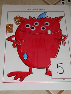 Monster Say It, Count It, Write It Math Mats  I assume you roll a dice and count that many eyes onto the monster and maybe write the number out.