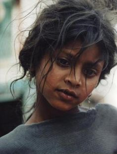 Nepal- no makeup- just a very exceptional face- a unique face- a interesting face. Looks like a young girl that has potential and will find her way. She looks 3rd World but has the face and hair. Very beautiful in her own right.