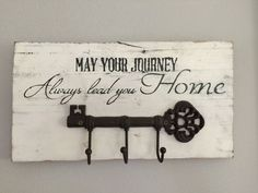 Barnwood sign May Your Journey Always Lead You Home with Key hook. White distressed with Antiqued Key Hook holder.  Each piece of wood is different and cannot be replicated but stencil and color of paints/stains will remain as close as possible.