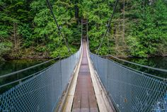 https://flic.kr/p/KSK3pT | Bunzten Lake Trail to North Beach | SUSPENSION BRIDGE  The Buntzen Lake Suspension Bridge is located in a 250 m long canal between Buntzen Lake and McCombe Lake.  If you are walking clockwise (west side of lake first) around the lake, you have completed about 60% of the full lake loop when you reach this location.  The 50 m long suspension bridge was constructed by: C.F.S.M.E. – QL3-9105 (F) Field Engineer, CFB Chilliwack and designed by Siefken Engineering.  It…