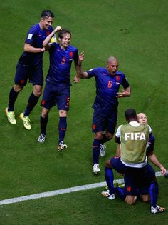 Arjen Robben of the Netherlands celebrates his teams second goal with Robin van Persie Daley Blind and Nigel de Jong during the 2014 FIFA World Cup. Nigel De Jong, Daley Blind, Robin Van, Van Persie, Basketball Court, Soccer, Fifa World Cup, Netherlands, Blinds