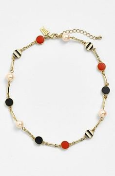 A nautical necklace by Kate Spade. Love the pearl, coral and striped discs.