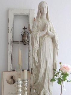 Madonna can be painted white if the colours are too garish. shabby chic shrine, pastel, candles. sacred heart