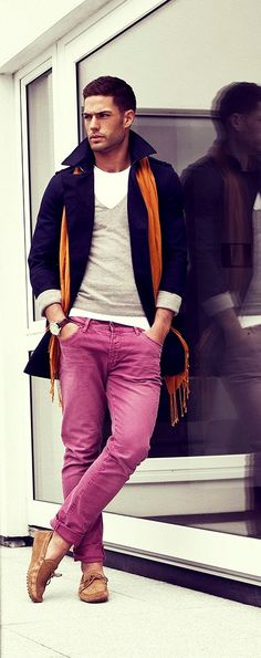 Opt for a navy trenchcoat and neon pink chinos for a sleek elegant look. Complement this stylish look with brown leather tassel loafers.  Shop this look for $284:  http://lookastic.com/men/looks/crew-neck-t-shirt-and-v-neck-sweater-and-scarf-and-trenchcoat-and-chinos-and-tassel-loafers/4021  — White Crew-neck T-shirt  — Grey V-neck Sweater  — Tobacco Scarf  — Navy Trenchcoat  — Neon Pink Chinos  — Brown Leather Tassel Loafers