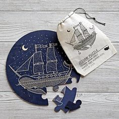 Our Wooden Ship Puzzle features 16 pieces and is designed by Brian Steely. This nautical-inspired set was handcrafted in the USA at a 100% wind-powered workshop. The puzzle pieces and matching drawstring bag were hand-printed with care.