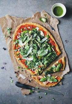 green pizza with a cauliflower dough