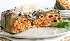 Pasta Timballo Surrounded by tender eggplant and filled with rigatoni pasta and tiny sausage meatballs, this impressive timballo is perfect for a big dinner party.