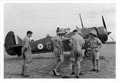 Australian pilots in WW2. Notice the two tone shoes of one of them.
