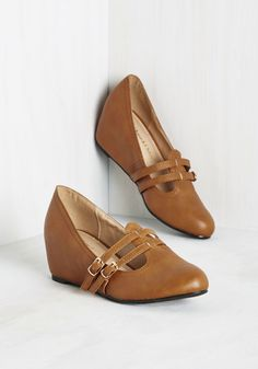 It's not just your lectures that are so impressive, but also how perfectly these cognac wedges complement your scholarly looks! Two slim straps and gold buckles add a touch of flair to this vegan faux-leather pair, while their classic and cute style makes conducting your lessons a joy.