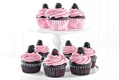 Adding jam to the icing not only colours it beautifully but also adds a berry flavour. These cupcakes look quite elegant and make an easy yet special finish to any summer event.