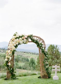 Wedding arch with flowers and greens