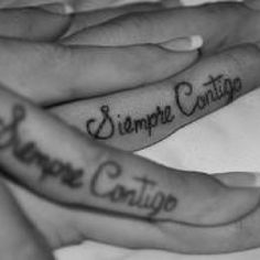 Siempre contigo--always with you. Mother-daughter tattoo. Like the idea but not on the finger.