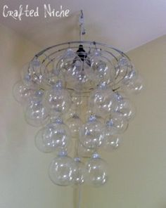 DIY chandelier made using clear glass Christmas ornaments.