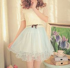 Very cute outfit with the white lace on top and the light blue on the bottom. Very pretty!