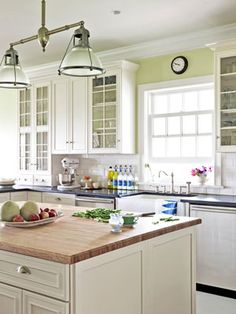 This kitchen sings with the perfect shade of green, Benjamin Moore's Chameleon.