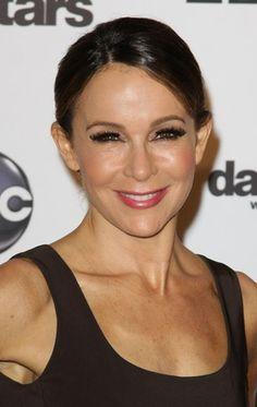 Jennifer Greys sleek, updo hairstyle