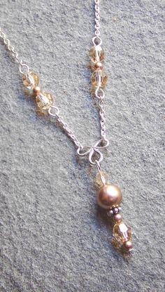 elegant bronze pearl necklace Swarovski by KandLJewelryDesigns Swarovski Jewelry, Wire Jewelry, Jewelry Crafts, Jewelry Art, Beaded Jewelry, Jewelery, Jewelry Necklaces, Jewelry Design, Fashion Jewelry