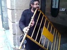 Street Musician Plays Railing Like a Flute