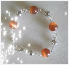Handmade Silver Bracelet with Orange Cat Eye by IreneDesign2011 in my Etsy Shop at https://www.etsy.com/listing/157565389