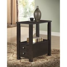 This functional side table has a beautiful cappuccino finish. The accent piece is ideal for use as a snack table, phone table, lamp table, or decorative display table. Two drawers provide extra storage to this sleek table.