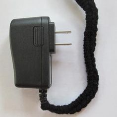 Crocheted Electric Cord Cover - made to discourage a cat from playing with the cord, but you could use it just to dress up a cord.