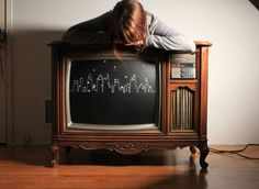Chalkboard paint on an old TV would make a great interactive table.