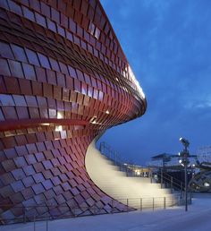 Renowned architectural photographers Hufton+Crow have captured Daniel Libeskind's dragon-inspired pavilion in a series of photos that highlight the shimmering tiles. The pavilion, which is currently welcoming visitors at the Milan Expo, was design. Architecture Today, Commercial Architecture, Light Architecture, Sustainable Architecture, Amazing Architecture, Architecture Details, Daniel Libeskind, Facade Lighting, Expo 2015