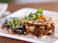 Chorizo-Potato Hash Browns with Black Beans and Salsa Verde recipe from Bobby Flay via Food Network