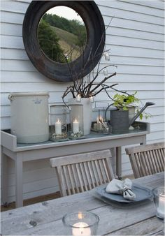 mirrors outside :) I love the grays and browns....can't decide which direction to go on my crafts/gardening shed