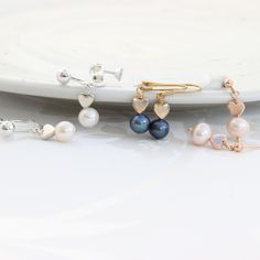 Pearl drop earrings with silver, rose gold or gold hearts. In pink, white or peacock pearls and fish hooks studs or clipon for non pierced ears Pearl Drop Earrings, Heart Earrings, Clip On Earrings, Silver Pearls, Silver Roses, Rose Gold, Ear Jewelry, Jewelry Gifts, Jewellery Earrings