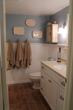 I like the idea of using hooks instead of towel racks, esp in a kids bathroom.