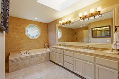 Check out the latest news from new home builder in Columbia, SC, McGuinn Hybrid Homes. Brown Bathroom, Wooden Bathroom, Frameless Mirror, Bathroom Vanity Cabinets, New Home Communities, Grey Tiles, Brick Patterns, New Home Builders, White Cabinets