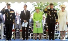 Royal salute: (Left to right) The Duke of Edinburgh, French Interior Minister Manuel Valls, The Queen, Prince Charles and his wife Camilla stand together as the ceremony at Bayeux begins
