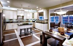 Toll Bros, very cool, love the square lines of the back splash and floors, black/white/stainless steel, love it!