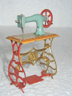 "Vintage Toy Sewing Machine  (Rozzie's Rugs, ""This reminds me of the one I put in Grandma's old purse and thought I would never get rid of it.  For safe keeping.  Then threw that neat old heirloom in the give to Good Will Bag ~~~ Blessed to know it was a treasure for someone else ♥"
