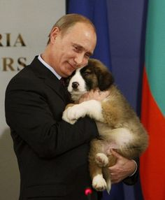 AND HE CUDDLES PUPPIES. | 32 Pictures That Prove Vladimir Putin Is Only Human
