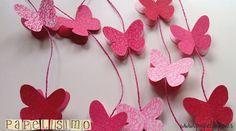 Siguiendo con la manualidades infantiles, vamos a crear una guirnalda de mariposas en tonos rosas. Es facilísima de hacer, y el efecto 3D de las mariposas crea