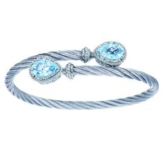 Gabriel Steel and Sterling Silver Cable Bangle Set With 5.11 Carats Sky Blue Pear Cut Topaz Available Immediately Bracelet fits standard 7 Inch wrist. Alternate