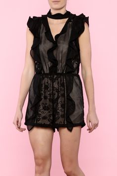 0ec6a016069 Ruffle detail choker neck romper. Contrast lining with net   lace overlay.  Button and
