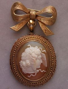 """Medusa""-Material: Cornelian Shell, 18 k gold tested.   Size: Total length 2 1/2"". Framed cameo is 1 5/8"" by 1 3/8"". Only cameo is 1 2/8"" by 1""   Date and Origin: Circa 1850/1860 Italy, frame is probably English."