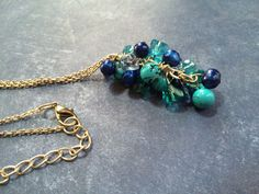 A personal favorite from my Etsy shop https://www.etsy.com/listing/246405062/blue-teal-and-silver-necklace