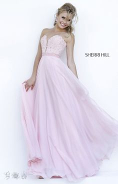 This stunning Sherri Hill 32180 gown features a strapless sweetheart neckline with a lace upper bodice and A line chiffon skirt. This formal gown is perfect for prom, a winter formal or military ball.
