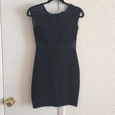 Black Bodycon Dress Used but still in good shape! Sheer from neck to bust, and also from below the bust to middle or top of waist depending on how long your waistline is. 74% polyester, 23% rayon, 3% spandex Foreign Exchange Dresses Mini